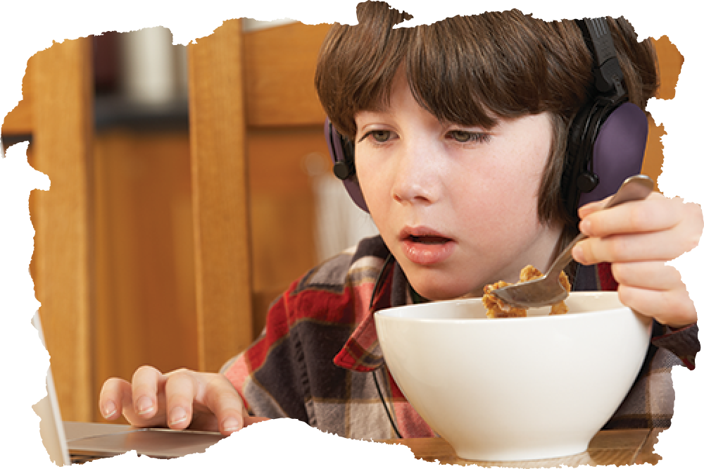 ADHD Child Eating and Using Computer